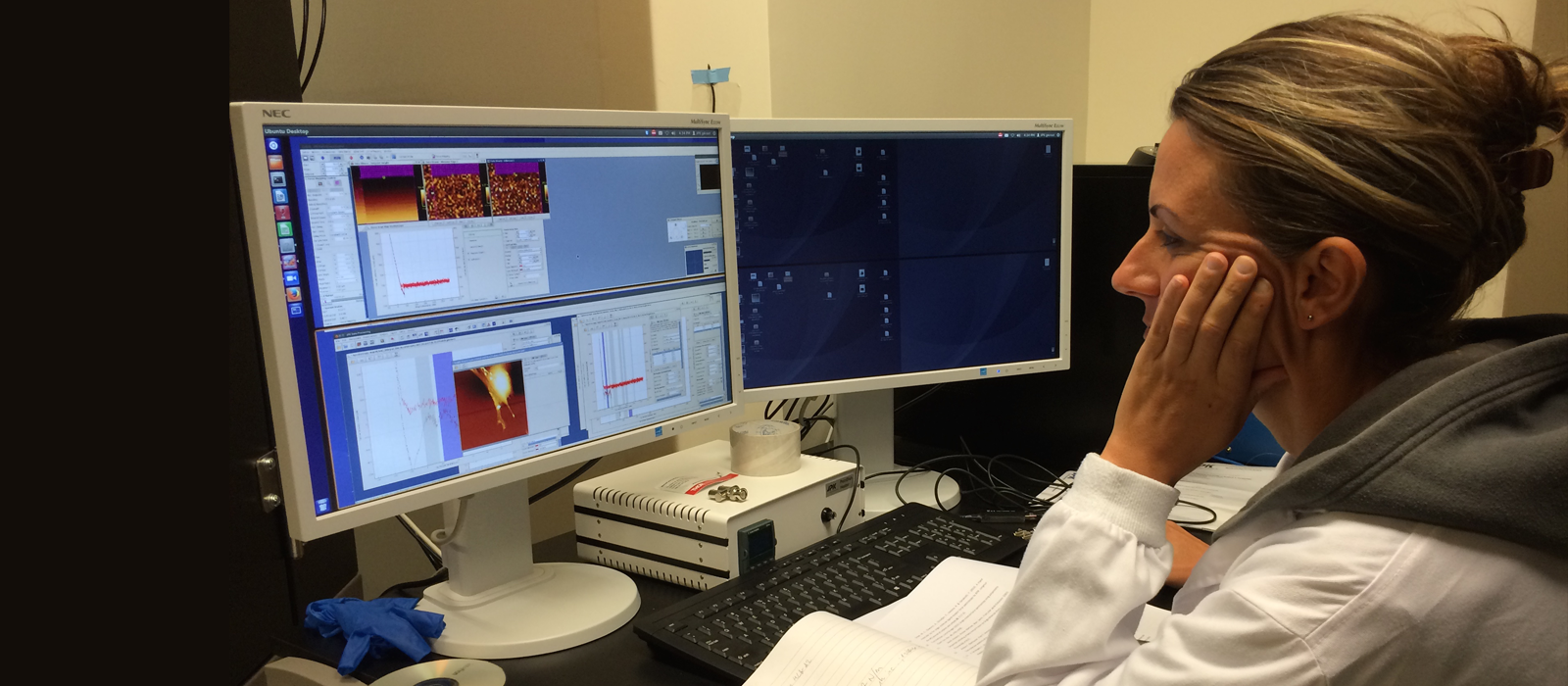 Researcher working on AFM set-up